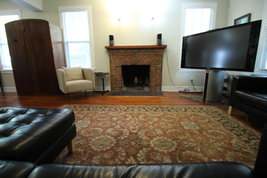 Living room with comfortable leather couches and chair and large-screen TV, XBOX/DVD, DVR,  basic cable plus HBO