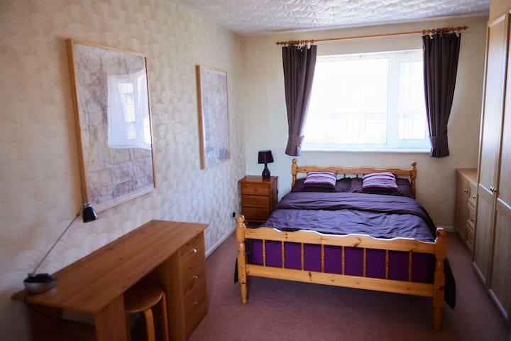 Double bed in large bedroom.  Blackout curtains provide a good nights sleep