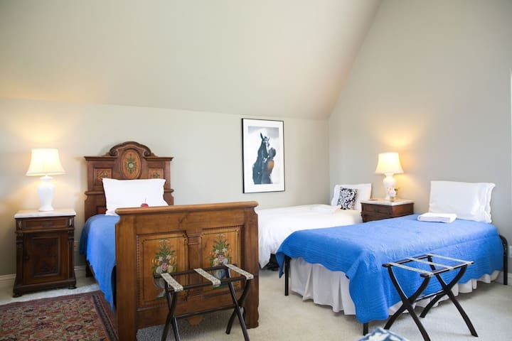 Three single beds in light-filled, airy Farm studio space.