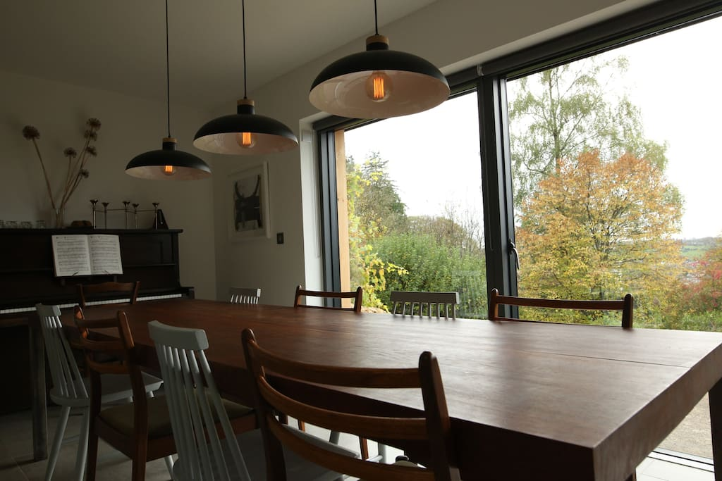Open plan dining area with 9ft teak table