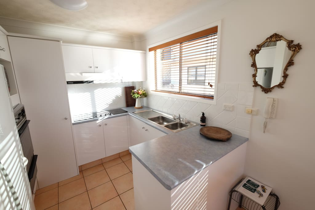 Full size kitchen with hot plates, oven, grill, fridge and freezer. Plenty of pots, pans and plates in storage.