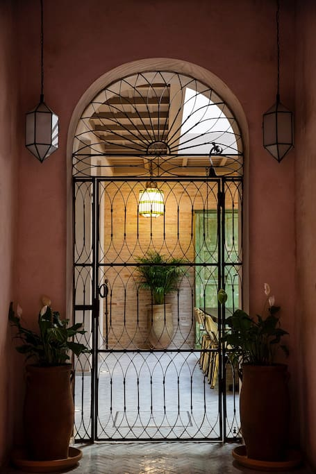 Entrance to the house showing the courtyard dining area.