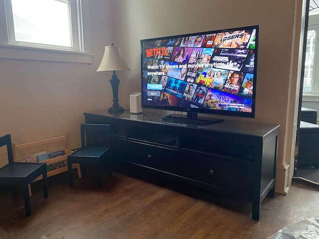 Living room TV with roku, Netflix and xfinity streaming