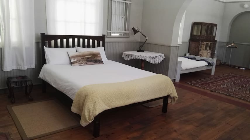 Double bed with white linen