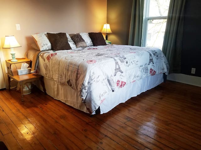 King size bed. Light dimming curtains and blinds.