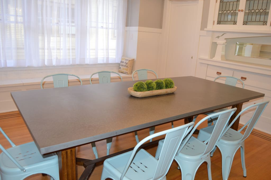 Zinc Table and Bistro Chairs and Window Bench for Extra Seating
