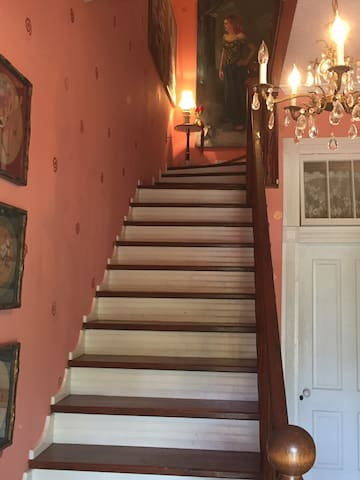 Staircase gallery to guest rooms.