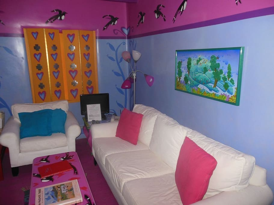 The living room is colorful and comfortable.