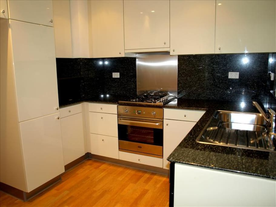 Fully equipped kitchen including 4 hobs, oven, microwave and fridge  freezer