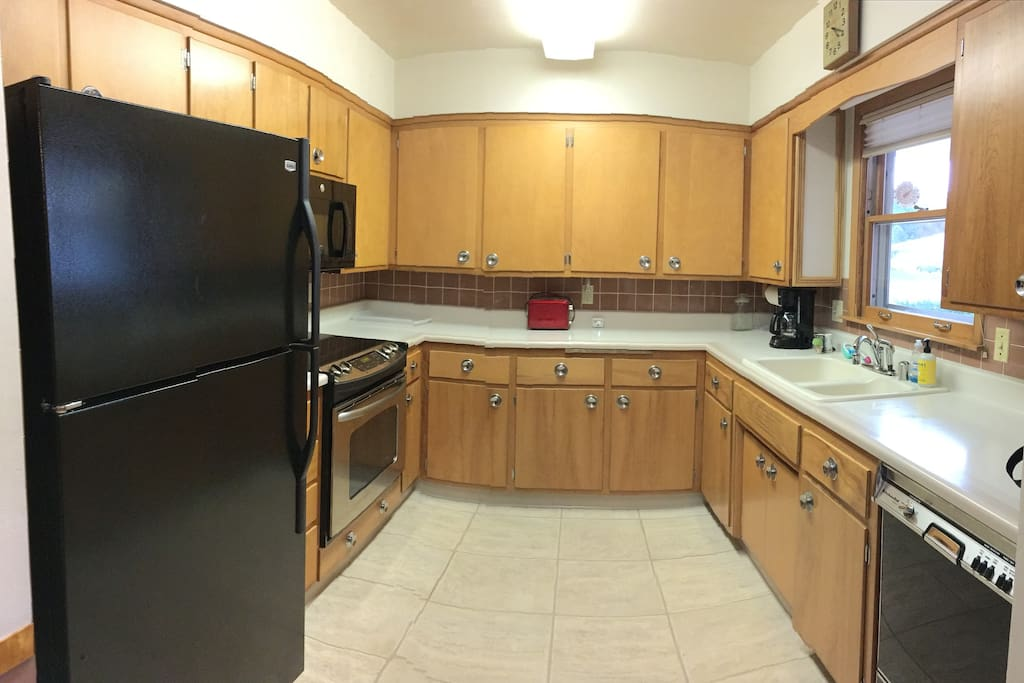 The fully equipped kitchen comes with everything you'd expect - coffee maker, toaster, and all the dishes and cookware you'll need.  There's a roomy fridge for food and beverages you bring, and a dishwasher to ease some of the cleanup work.