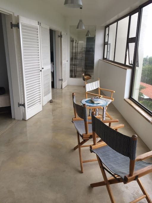 The two master bedrooms, both with queen beds, have louvered doors leading out onto the enclosed veranda.