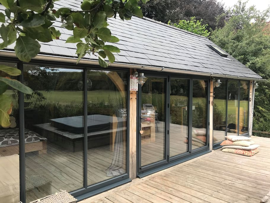 Bi-fold windows in the centre open to enjoy the space and the decked area