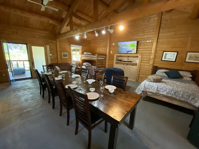 Cabin dining area and bedding (queen bed and bunk beds)