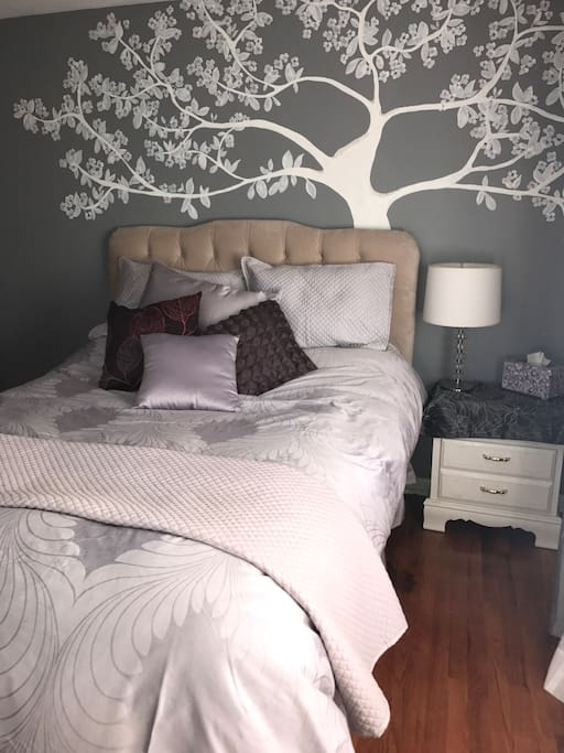 Beautiful lavender room with queen size bed and night stand
