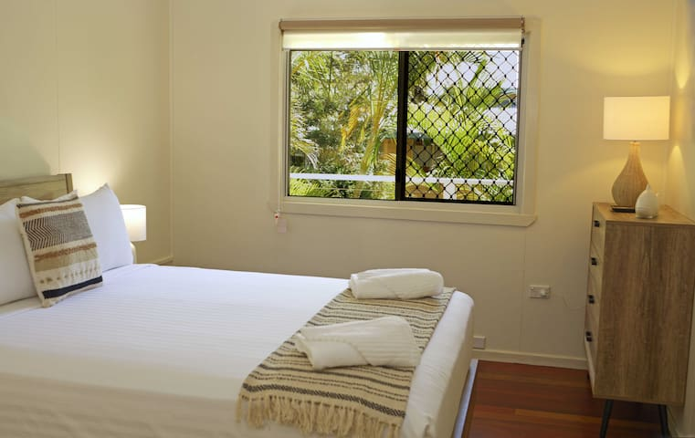 Your Master Bedroom is spacious and tranquil with palm leaves and views of the bay to wake up to.