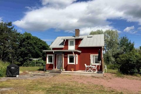 Mysig stuga på Åland nära golfbana/historisk miljö