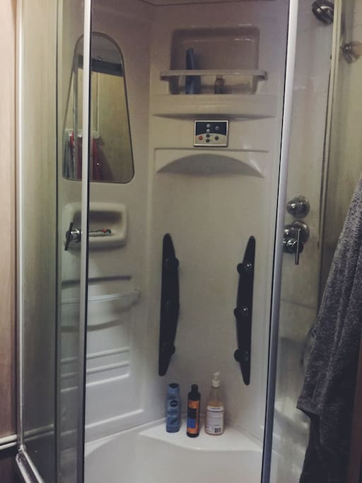 Bathroom has a shower cabin