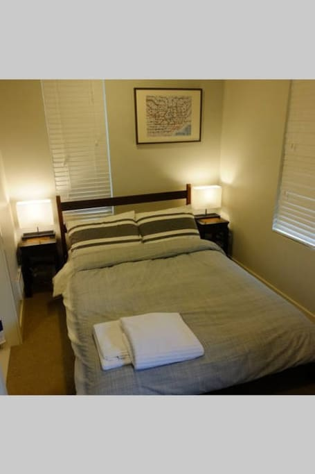 Nice full size bed with gel foam mattress top, thick duvet, and comfy sheets.