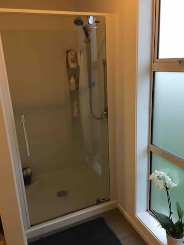 Shower in shared bathroom.