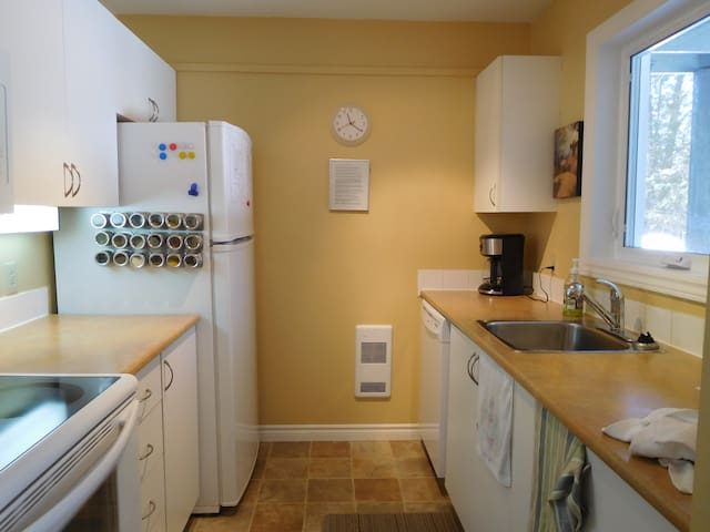 Full size kitchen appliances with loads of pots and pans and basic home supplies for your short term stay.