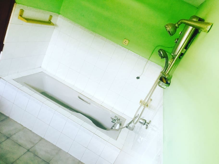 Washroom with tub and hotwater