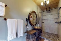 Large Bathroom with unique Rainfall shower head and copper sink.