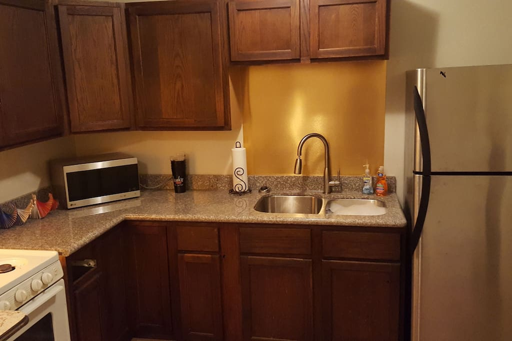 Kitchen with Microwave, gas oven new sink with Refrigerator with ice maker....