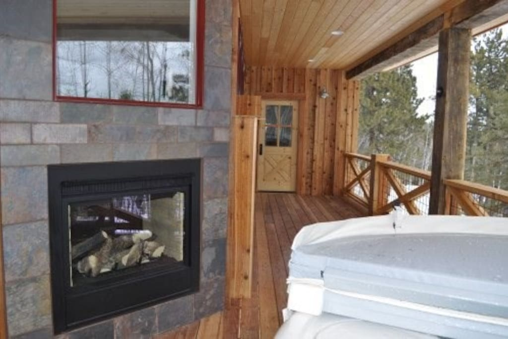 Relax out on the deck in the hot tub next to the see-thru fireplace.