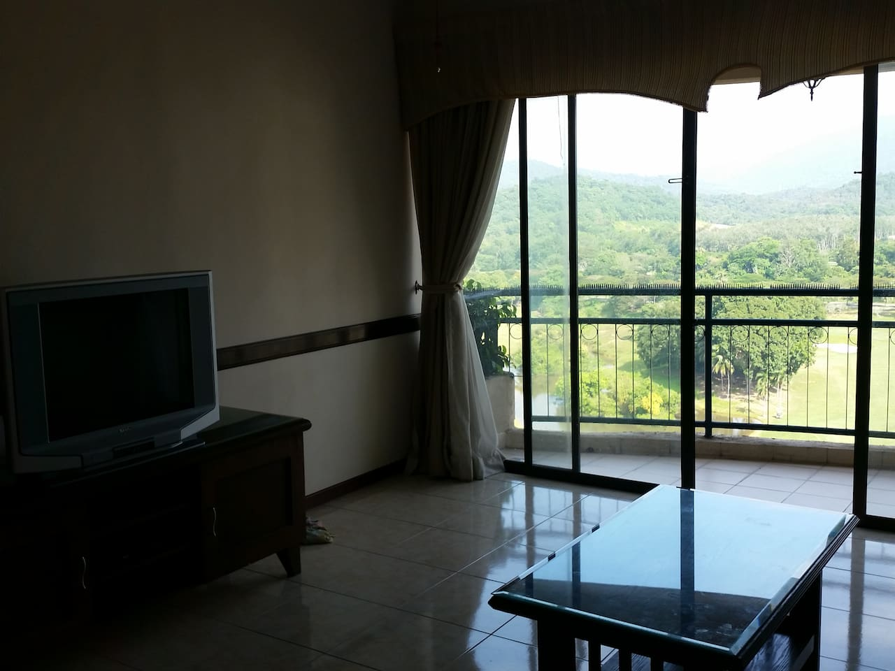 Aircond living room with balcony facing golf course.