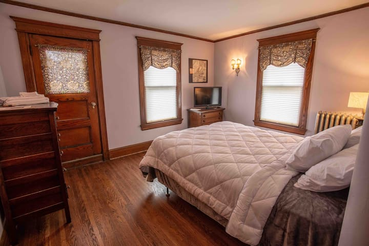 Bedroom #2, on second floor, queen sized bed, ultrasoft microfiber sheets and a down alternative comforter. Closet has an extra blanket in it. Room includes 2 dressers, a mirror, clock/radio, tv with remote and digital antenna.