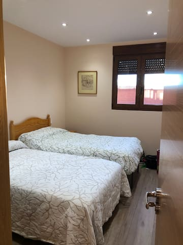 One of two bedrooms with single beds.