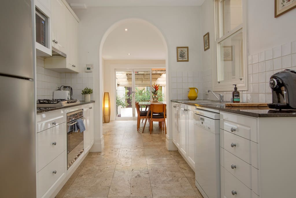 Bright Galley style kitchen leading to light filled dining & courtyard. Fully stocked with all appliances/pots & pans/ cutlery etc.