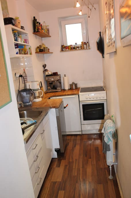 kitchen with automatic dish cleaner and espresso machine