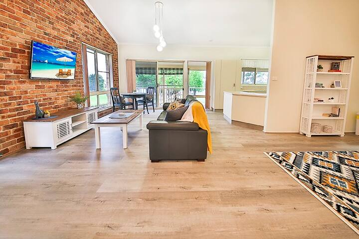 Light and airy open plan living, with smart TV and views to the river.