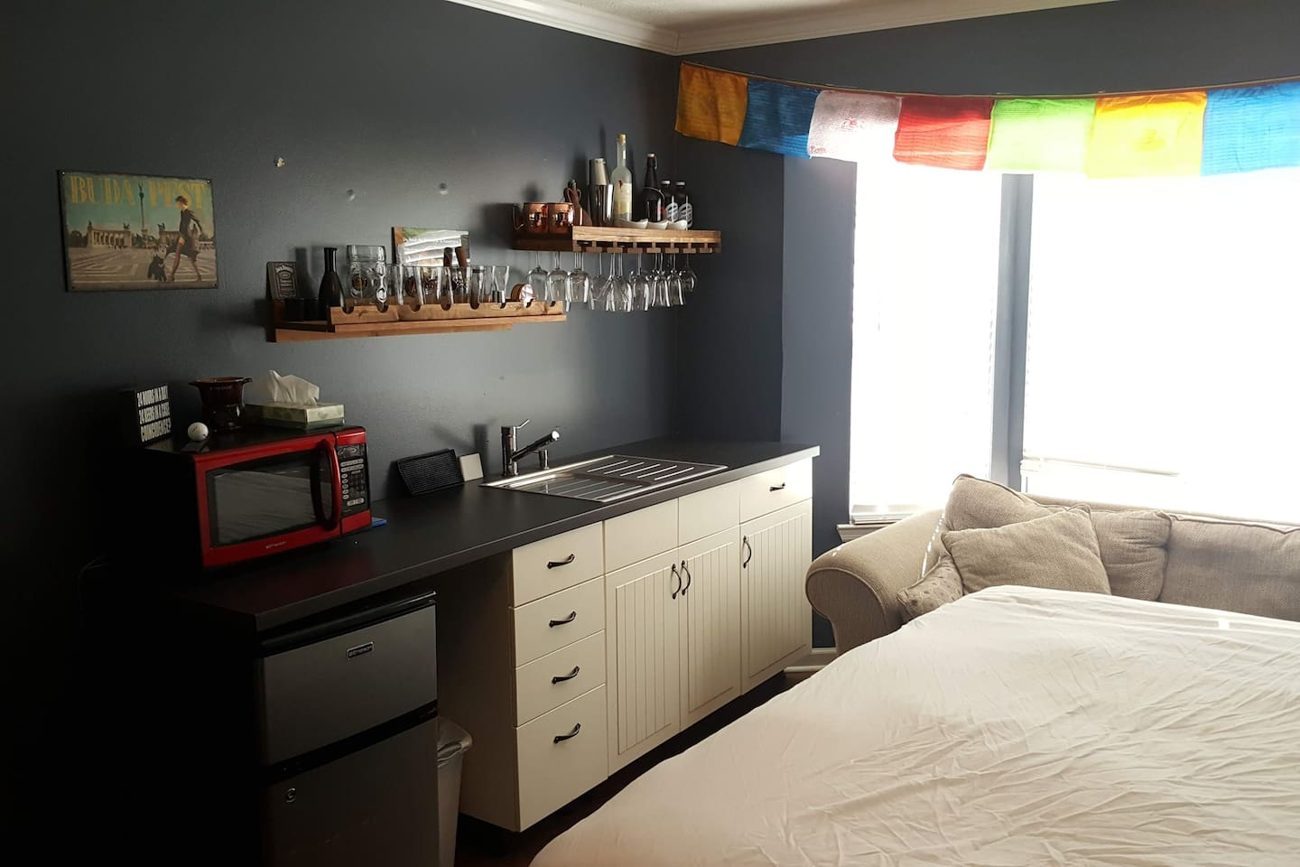 Great queen size bed with a bar/coffee area just for you