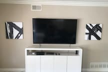 """60"""" TV equipped with Cable and Streaming Device for Netflix, Hulu, and other platforms."""