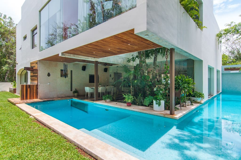 The backyard pool, with natural salt water that won't irritate your eyes, wraps around 50% of the house.