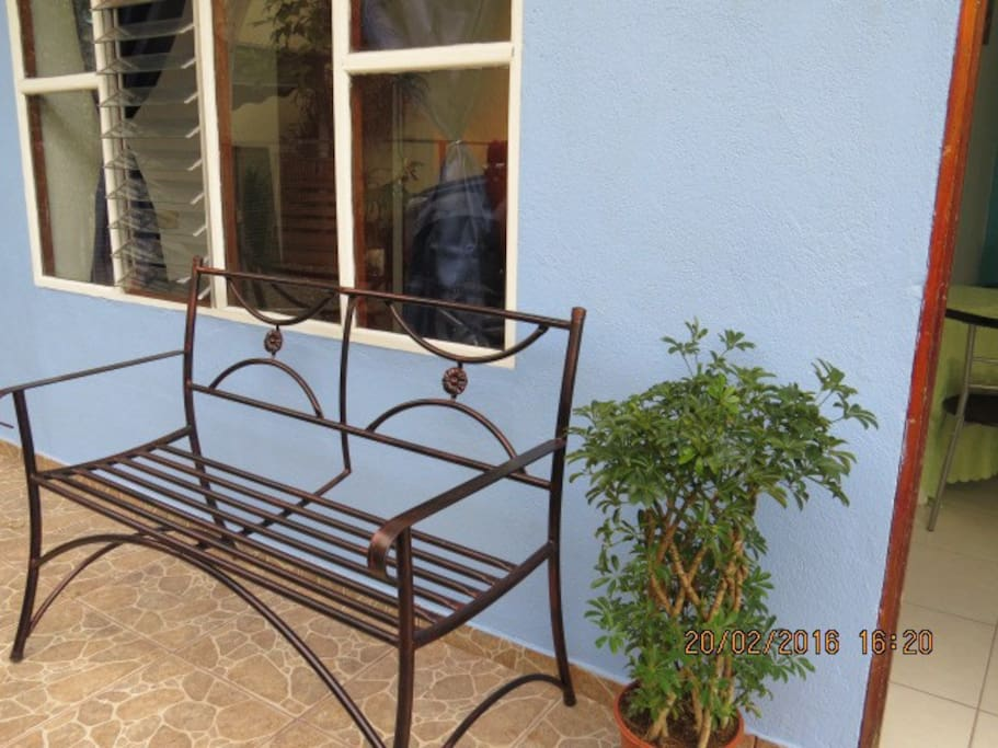 Wrough iron bench. Perfect for taking some air and reading spot!