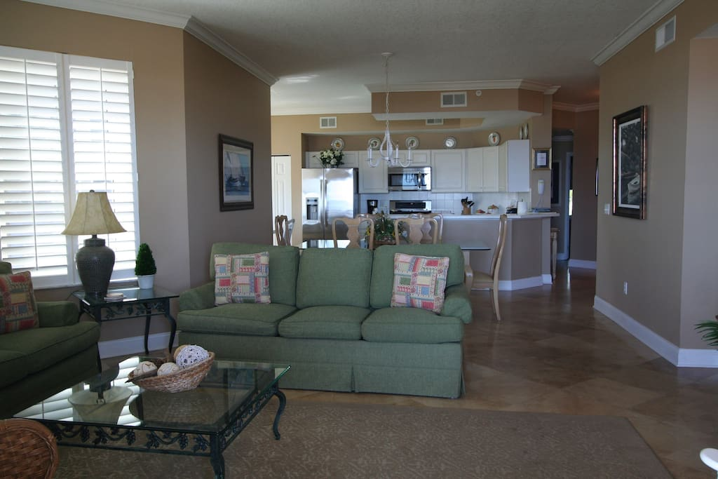 Family Room with 2 full couches and High Def Flat Screen TV and located with view of ocean with access to the oversized balcony.