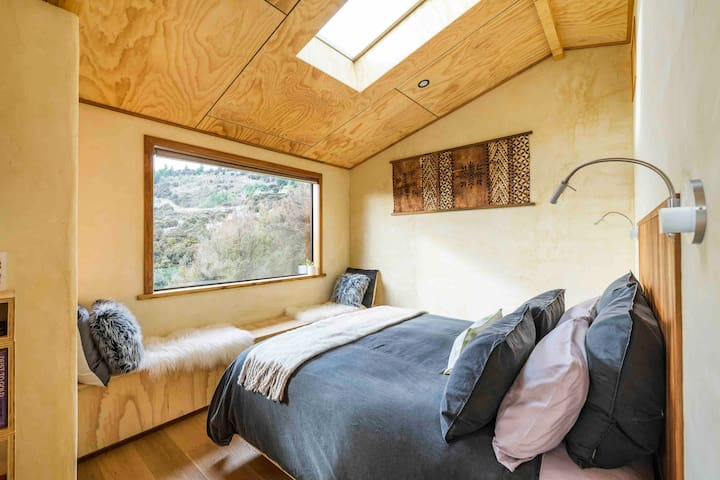 Cosy bedroom with skylight for stargazing.