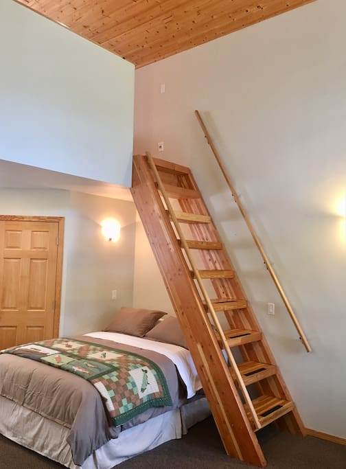 "View of the ""stairs"" to the loft and first floor queen size bed. **The ladder is the only way to access the loft"