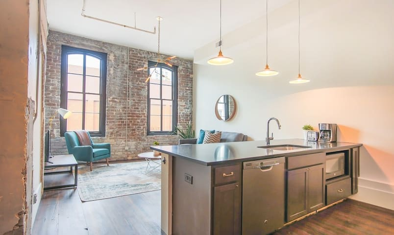 Vaulted ceilings and exposed brick.