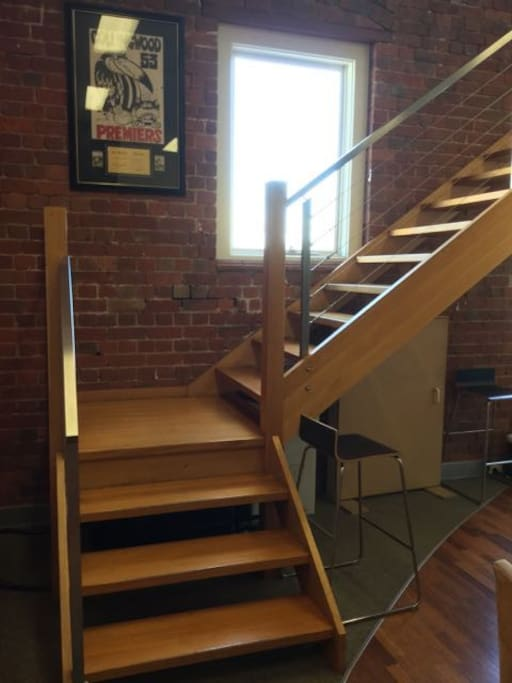 Stairs to second floor where the desk is located