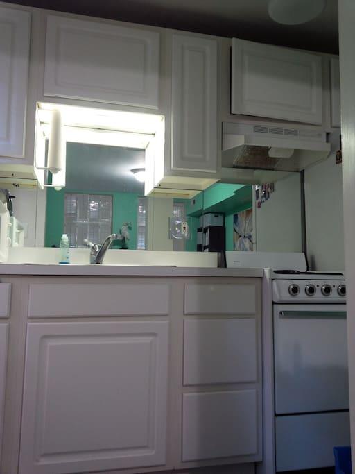 Kitchen with microwave, range.