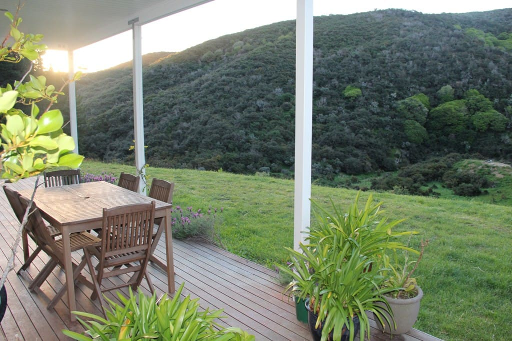 Tables and chairs on the deck at the front of the house