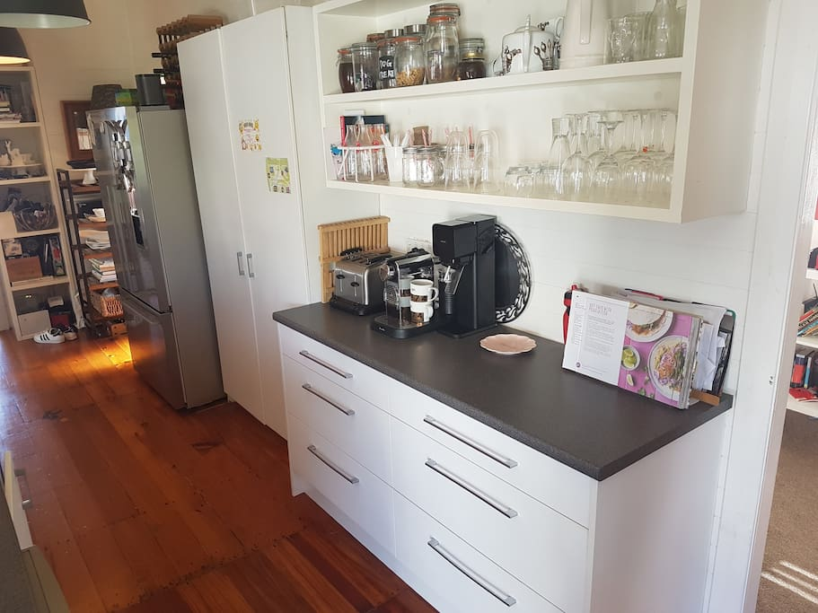 Modern kitchen includes double door fridge, pyrolytic oven and Nespresso machine