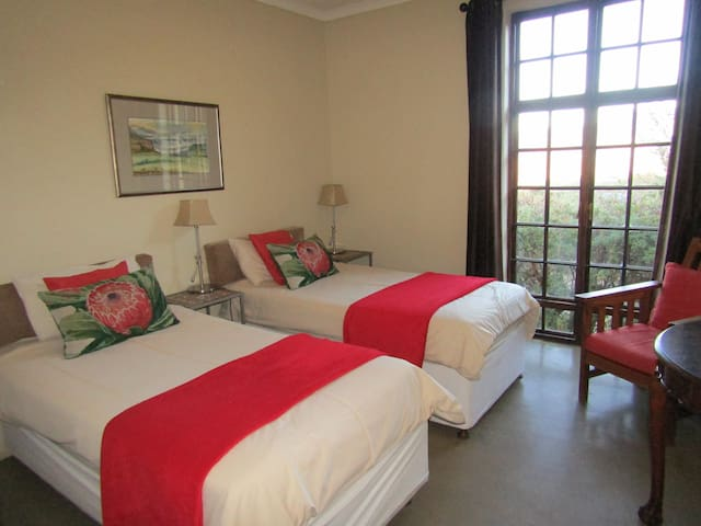 The second bedroom of the Chalet. The twin beds are made up as a king size on request.