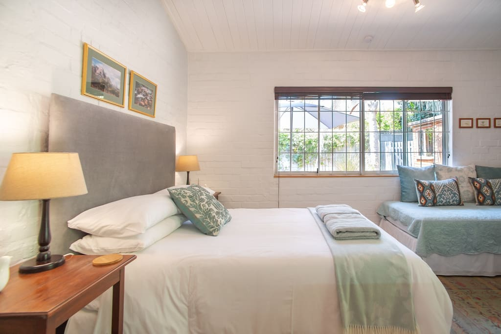 The studio is a restful space with a very comfortable double bed and a single bed suitable for an adult or a child. There is also a camp cot for infants.