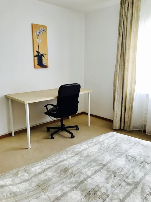 The desk is convinient for writing, reading....