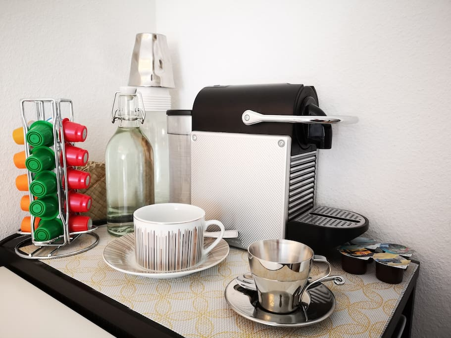 Nespresso coffee machine (free caps) and tea boiler (free bags) with Swiss chocolate and some snack are at your disposal in your room